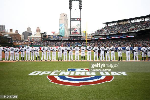 The Detroit Tigers and Kansas City Royals look on during the National Anthem during Opening Day at Comerica Park on April 04 2019 in Detroit Michigan