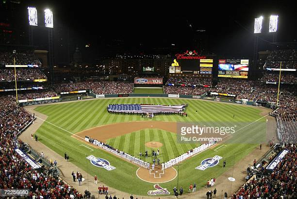 The Detroit Tigers and the St Louis Cardinals line up on the field during the singing of the National Anthem before Game Three of the 2006 World...