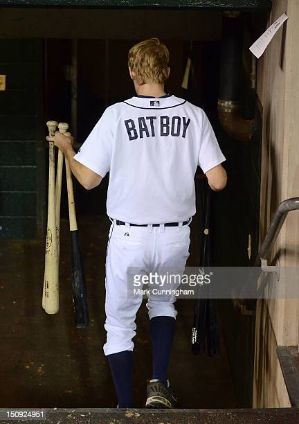 The Detroit Tigers bat boy walks to the clubhouse with a group of baseball bats after the game against the Baltimore Orioles at Comerica Park on...