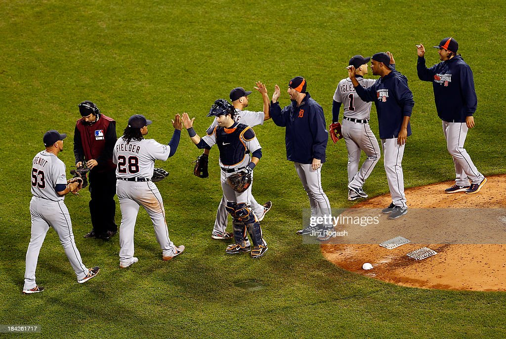 The Detroit Tigers celebrate after defeating the Boston Red Sox 1-0 in Game One of the American League Championship Series at Fenway Park on October 12, 2013 in Boston, Massachusetts.