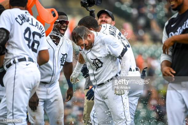 The Detroit Tigers celebrate their win against the Houston Astros by pouring water on Robbie Grossman of the Detroit Tigers during the bottom of the...