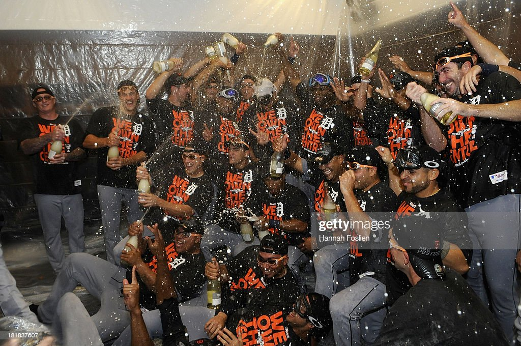The Detroit Tigers celebrate with champagne in the clubhouse after the Tigers defeated the Twins 1-0 on September 25, 2013 at Target Field in Minneapolis, Minnesota. The Tigers clinched the American League Central Division title.