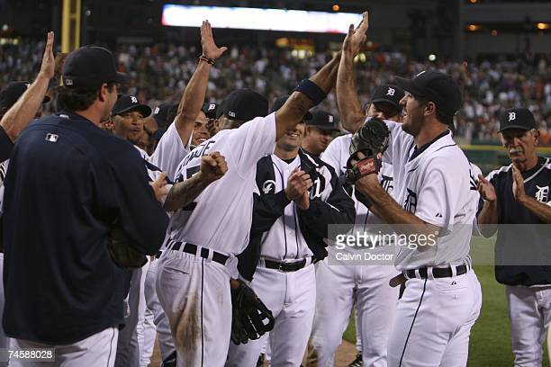 The Detroit Tigers celebrate with pitcher Justin Verlander after he pitched a nohitter against the Milwaukee Brewers at Comerica Park in Detroit...