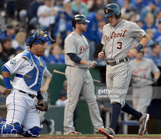 The Detroit Tigers' Ian Kinsler scores past Kansas City Royals catcher Salvador Perez on a single by Victor Martinez in the sixth inning on...