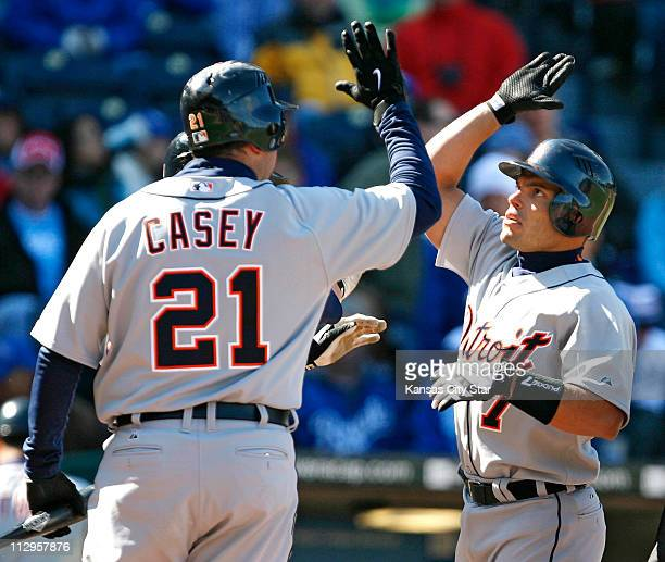 The Detroit Tigers' Ivan Rodriguez is congratulated at the plate by teammate Sean Casey following his 3run home run in the ninth inning against the...