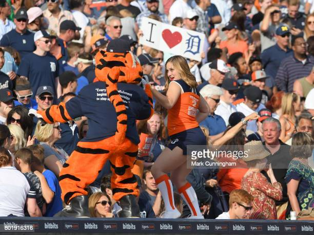 The Detroit Tigers mascot Paws and a member of the Energy Squad entertain the crowd during the game against the Chicago White Sox at Comerica Park on...