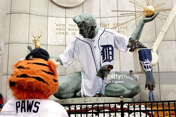 The Detroit Tigers mascot, watches the Spirit of Detroit statue get dressed in a giant Detroit Tigers jersey October 20, 2006 in Detroit, Michigan....