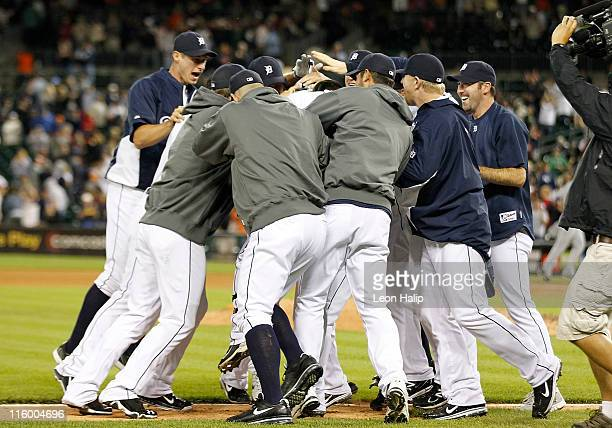 The Detroit Tigers mob teammate Ramon Santiago after his game winning triple in the tenth inning scoring Victor Martinez as the Tigers defeated the...