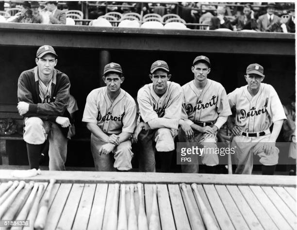 The Detroit Tigers pitching staff with manager Mickey Cochrane in the dugout at Navin Field during the American League pennant doubleheader against...