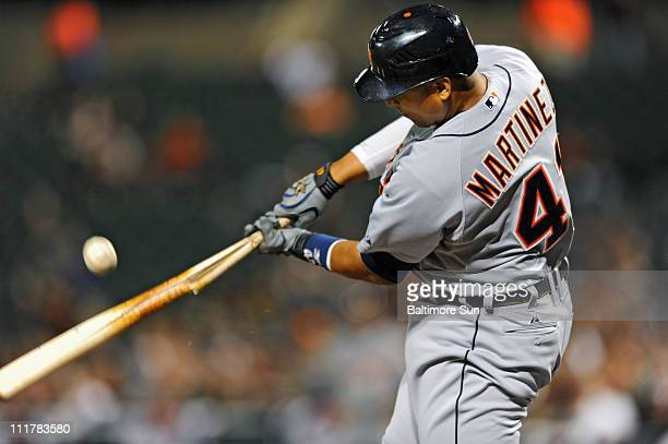 The Detroit Tigers' Victor Martinez breaks his bat hitting a single in the fourth inning against the Baltimore Orioles at Oriole Park at Camden Yards...