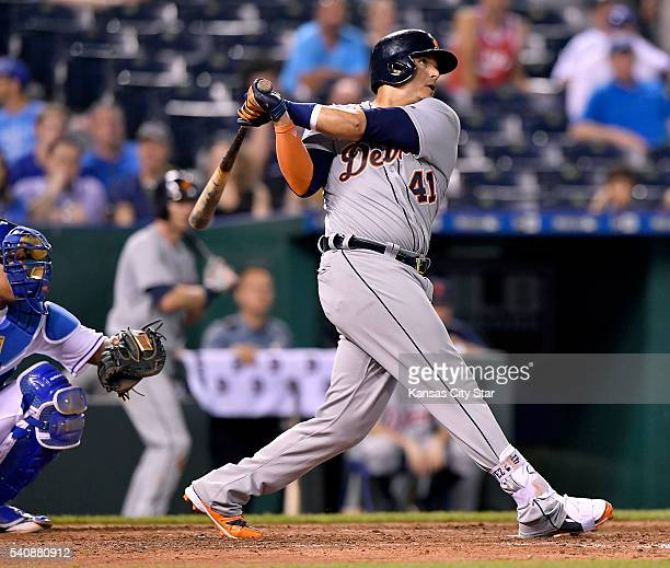 The Detroit Tigers' Victor Martinez follows through on his third home run of the game in the ninth inning off Kansas City Royals relief pitcher...