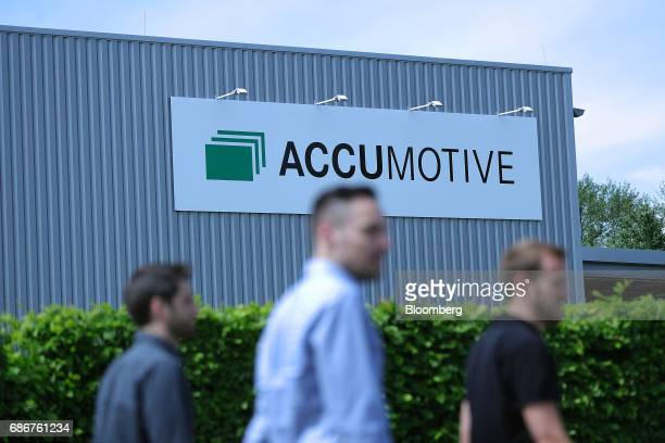 The Deutsche Accumotive GmbH logo sits on the exterior of the company's electric automobile battery factory operated by Daimler AG in Kamenz Germany...