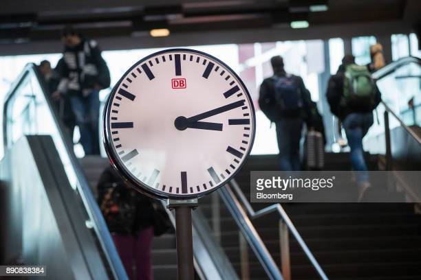 The Deutsche Bahn AG logo sits on a clockface at Berlin Central Station in Berlin Germany on Friday Dec 8 2017 Germany's Chancellor Angela Merkel's...