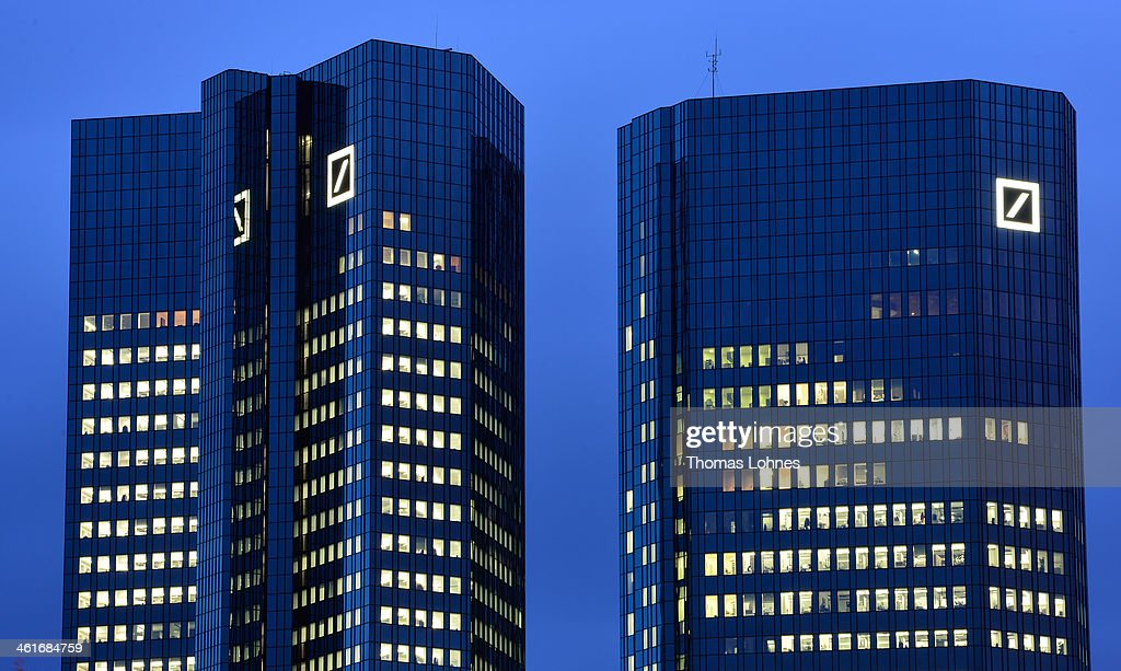 The Deutsche Bank AG headquarters stands illuminated in the twilight on January 09, 2014 in Frankfurt am Main, Germany. Many of Germany's biggest banks will be announcing their financial results for 2013 in the coming weeks.