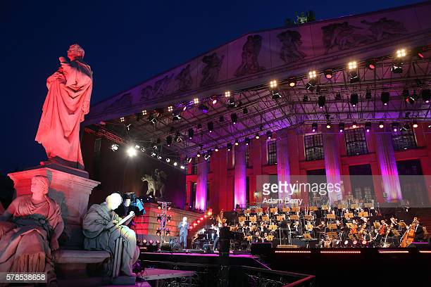 The Deutsche Filmorchester Babelsberg performs at the opening night of the Classic Open Air festival at Gendarmenmarkt on July 21 2016 in Berlin...