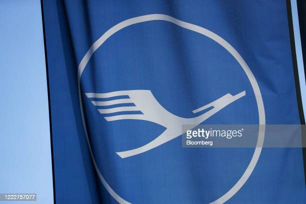 The Deutsche Lufthansa AG logo sits on a banner flying outside the airline's first class passenger terminal at Frankfurt Airport in Frankfurt Germany...