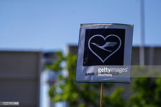 The Deutsche Lufthansa AG logo sits on a banner reading Save Our Souls' during a protest by the airline's employees and union members outside the...