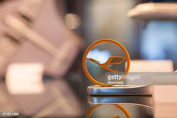 The Deutsche Lufthansa AG logo sits on display during the airline's annual general meeting in Hamburg Germany on Wednesday April 29 2015 Lufthansa...