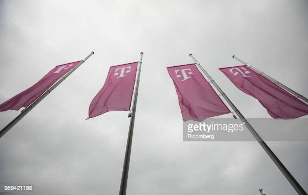 The Deutsche Telekom AG logo sits on banners flying outside the company's shareholders' meeting in Bonn Germany on Thursday May 17 2018 Deutsche...