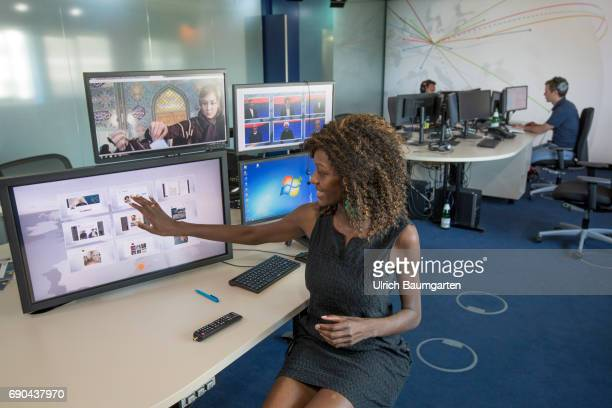 The Deutsche Welle Radio and TV broadcasts from Germany into the world The photo shows a moderator female from Tanzania in the social media studio