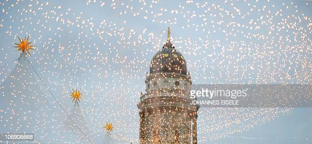 The Deutscher Dom and tents and fairy lights of a Christmas market reflect in a window on November 16 2010 in Berlin Across the country preparations...