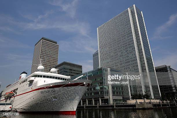 The MS Deutschland cruise ship moored in the South Quay dock surrounded by the financial distric of Canary Wharf on July 25 2012 in London England...