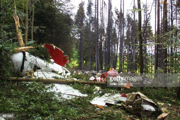 The devastated front section of a DHL Boeing 757 cargo plane lies in a forest July 2 2002 near the town of Taisersdorf Germany The aircraft collided...