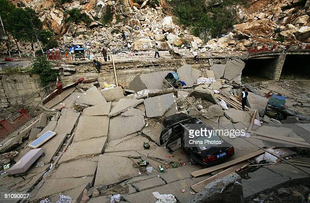 The devastation created by a collapsed road on May 14 2008 in Beichuan County one of the hardhit cities of Sichuan province China A major earthquake...