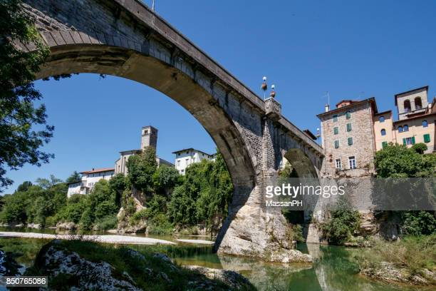 the devil's bridge seen from the bed of natisone - friuli venezia giulia stock photos and pictures
