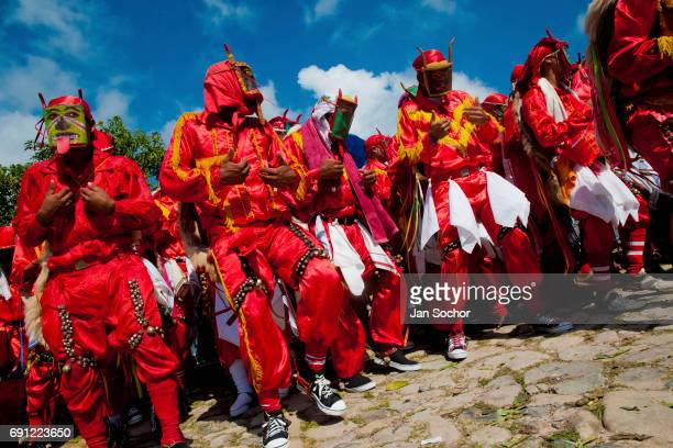The Devils dance and play castanets during the religious procession as part of Dancing Devils Festival on June 03 2010 in Atanquez Sierra Nevada...