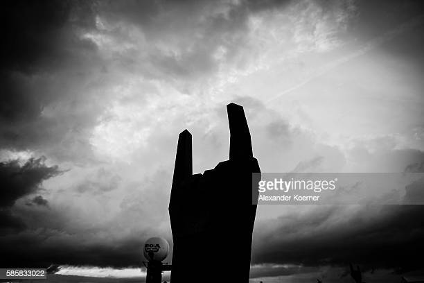 The devils horns of the Wacken Open Air festival are silhouetted again rain clouds on August 4 2016 in Wacken Germany Wacken is a village in northern...