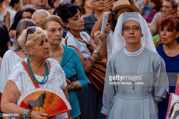 The devotees during the solemn Celebration and processions in honor of Madonna del Carmine in the Rione Borgo at Via della Conciliazione on July 15...
