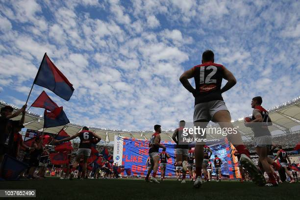The Dewmons run out onto the field during the AFL Preliminary Final match between the West Coast Eagles and the Melbourne Demons on September 22 2018...