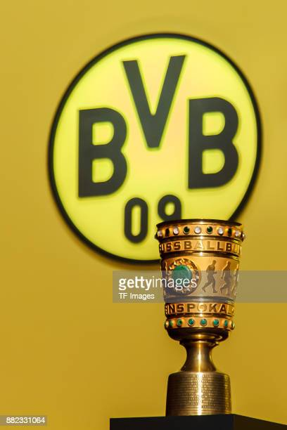 The DFB Pokal Trophy are seen during the annual general meeting of German first division Bundesliga football club Borussia Dortmund on November 26...