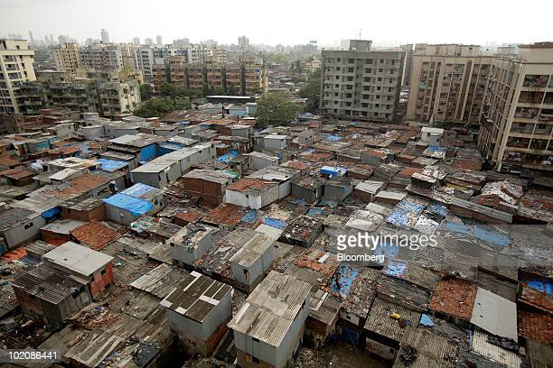The Dharavi slum sits tucked under multistory buildings in Mumbai India on Saturday June 12 2010 As Hyderabadbased SKS Microfinance Pvt plans to...