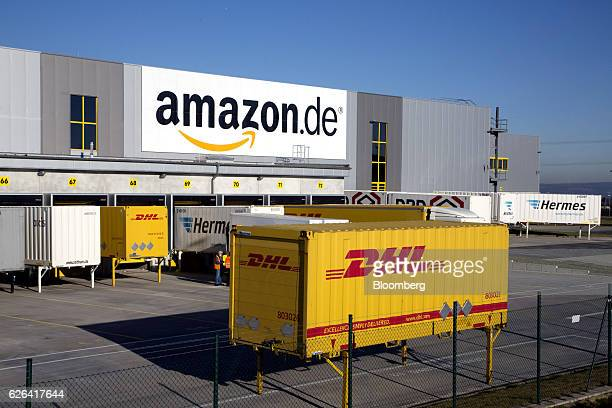 The DHL logo sits on a shipping container outside an Amazoncom Inc fulfillment center in Koblenz Germany on Tuesday Nov 29 2016 Ecommerce sales in...