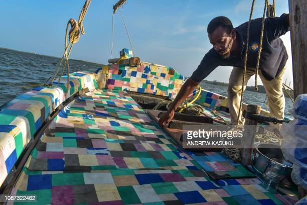 TOPSHOT The dhow made by recycled plastic floats during its official voyage launch at Lamu Island northern coast of Kenya on January 23 2019...