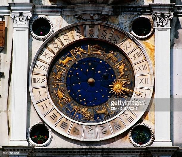 The dial of the clock tower 15th century St Mark's square Venice Veneto Italy