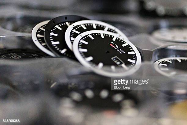 The dials to be used for Evo official Swiss Railways model wristwatches sit stacked ahead of assembly at the Mondaine Watch Ltd production facility...