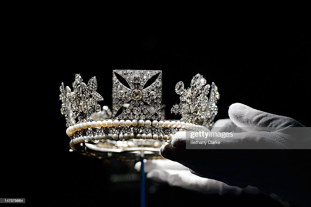 ( The Diamond Diadem Tiara, worn by The Queen on British and Commonwealth stamps, which also features on some issues of coinage and bank notes, at the Diamonds: A Jubilee Celebration exhibition which forms part of the summer opening of Buckingham Palace on June 28, 2012 in London, England. 10,000 diamonds set in works acquired by six monarchs over three centuries go on display to mark Queen Elizabeth II's 60 year reign. With many items from the Queen's personal collection joining those chosen for their artistic significance and historical importance from the Royal Collection. The exhibition opens on Saturday and runs til 8th July and then again from July 31 to October 7.