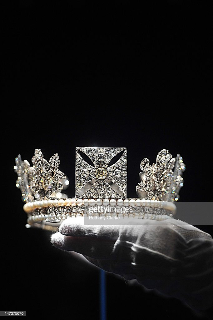 The Diamond Diadem Tiara, worn by The Queen on British and Commonwealth stamps, which also features on some issues of coinage and bank notes, at the Diamonds: A Jubilee Celebration exhibition which forms part of the summer opening of Buckingham Palace on June 28, 2012 in London, England. 10,000 diamonds set in works acquired by six monarchs over three centuries go on display to mark Queen Elizabeth II's 60 year reign. With many items from the Queen's personal collection joining those chosen for their artistic significance and historical importance from the Royal Collection. The exhibition opens on Saturday and runs til 8th July and then again from July 31 to October 7.