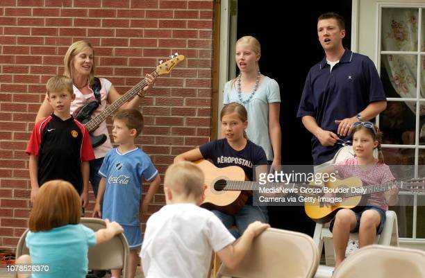 The Diamond family entertain friends and neighbors at Ben's birthday party front row from left Luke Matthew Kate Gabby back row from left Andrea...