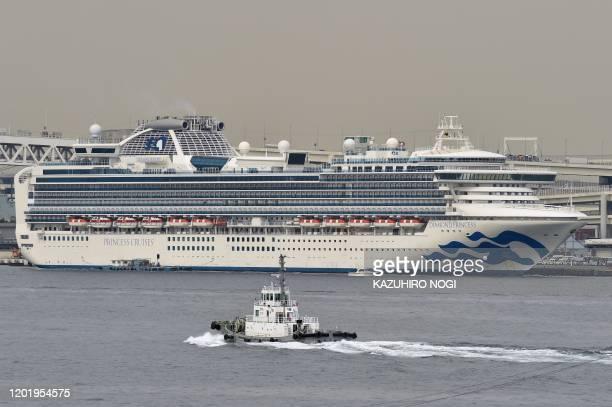 The Diamond Princess cruise ship in quarantine due to fears of the new COVID19 coronavirus is seen at the Daikoku Pier Cruise Terminal in Yokohama on...