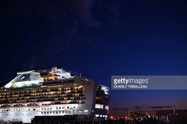 TOPSHOT The Diamond Princess cruise ship is pictured at dusk at the Daikoku Pier Cruise Terminal in Yokohama port on February 18 2020 The Diamond...