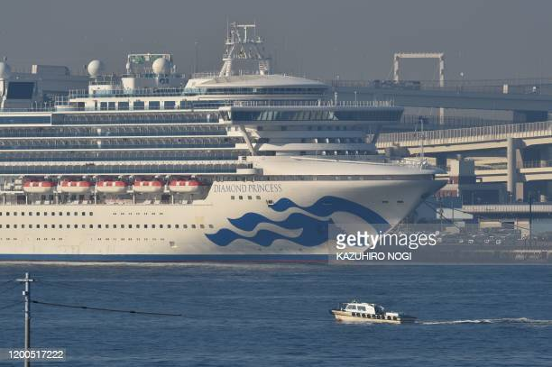 The Diamond Princess cruise ship is seen anchored at the Daikoku Pier Cruise Terminal in Yokohama port on February 13, 2020. - At least 218 people on...
