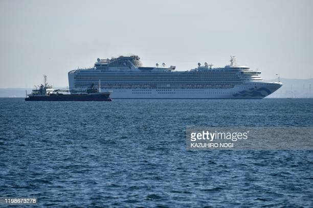 The Diamond Princess cruise ship is seen off the port of Yokohama on February 5, 2020. - At least 10 people on a cruise ship quarantined off the...
