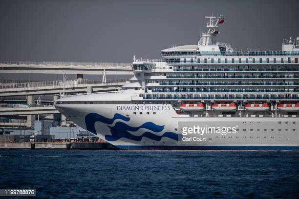 The Diamond Princess cruise ship sits docked at Daikoku Pier where it is being resupplied and newly diagnosed coronavirus cases taken for treatment...