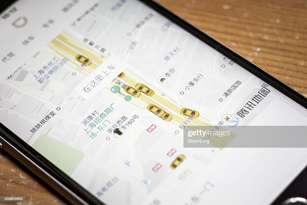 The Didi Chuxing application is displayed on a smartphone screen in this arranged photograph taken in Shanghai, China, on Sunday, May 22, 2016. Philippe Laffont's Coatue Management LLC, which manages more than $7 billion, has backed China's biggest ride-hailing app Didi Chuxing as it competes with Uber Technologies Inc. Photographer: Qilai Shen/Bloomberg via Getty Images