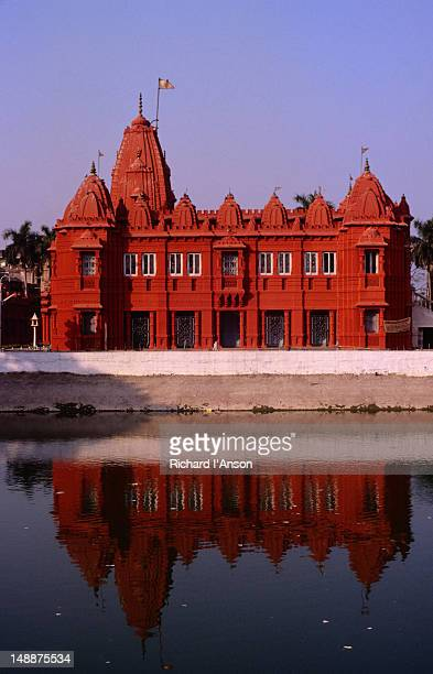the digambara jain temple reflected on still waters. - digambara stock-fotos und bilder