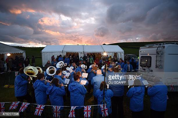 The Diggle Brass Band compete in the Whit Friday brass band competition as the sun sets in the village of Scouthead near Oldham northern England on...